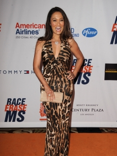 In an animal print gown, Tia Carrere arrives at the 18th Annual Race To Erase MS at the Hyatt Regency Century Plaza, Los Angeles, on April 29, 2011