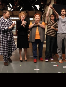 "Ashton Kutcher waves during the curtain call after filming the season premiere episode of ""Two and a Half Men,"" alongside Marin Hinkle, Jon Cryer, Holland Taylor, Conchata Ferrell and Angus T. Jones"