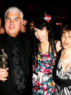 Amy Winehouse, her father Mitch and mother Janis pose with Amy's award for Best Song Musically and Lyrically for 'Love Is A Losing Game' at the 53rd Ivor Novello Awards at the Grosvenor House Hotel, London, on May 22, 2008