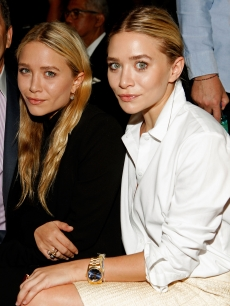 Mary-Kate Olsen and Ashley Olsen pose at FIJI Water at the J. Mendel Spring 2012 show during Mercedes-Benz Fashion Week in New York City on September 14, 2011