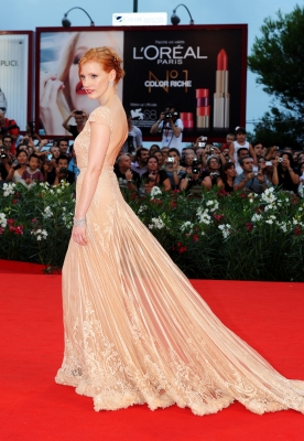 Jessica Chastain ahines on the red carpet at the 'Wilde Salome' premiere during the 68th Venice International Film Festival at Palazzo del Cinema in Venice, Italy, on September 4, 2011