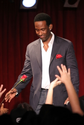 Shawn Stockman hands our roses during a performance at B.B. King Blues Club & Grill in New York City on March 10, 2011.