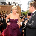Access Hollywood&#8217;s Billy Bush lends a hand to Emmy host Jane Lynch on the red carpet in Los Angeles on September 18, 2011