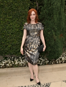 Christina Hendricks in a leopard-print frock in Los Angeles on September 25, 2011