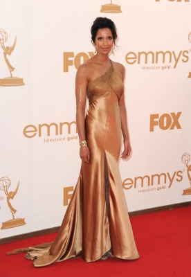 &#8216;Top Chef&#8217;s&#8217; Padma Lakshmi works a gold gown at the 63rd Primetime Emmy Awards on September 18, 2011 in Los Angeles