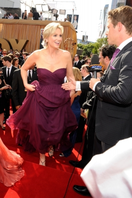 Access Hollywood's Billy Bush lends a hand to Emmy host Jane Lynch on the red carpet in Los Angeles on September 18, 2011