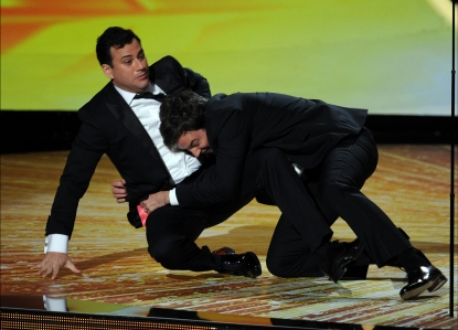 Jimmy Kimmel and Jimmy Fallon wrestle onstage during the 63rd Annual Primetime Emmy Awards held at Nokia Theatre