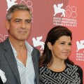 George Clooney and Marisa Tomei attend the 'The Ides of March' photocall during the 68th Venice International Film Festival at Palazzo del Casino in Venice on August 31, 2011