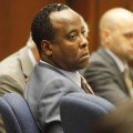 Dr. Conrad Murray watches Alberto Alvarez, one of Michael Jackson's security guards, testify during his involuntary manslaughter trial at the Los Angeles Superior Court in downtown Los Angeles on September 29, 2011