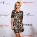 Charlize Theron arrives at REACH: 24 Portraits by Randall Slavin Benefitting The Charlize Theron Africa Outreach Project at The Annenberg Space for Photography in Los Angeles on October 12, 2011