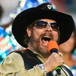 Singer Hank Williams Jr. appears on the field before a NFL game between the New England Patriots and the Miami Dolphins at Sun Life Stadium on September 12, 2011