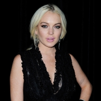 Lindsay Lohan is spotted at the Givenchy aftershow party at L'Arc in Paris on October 2, 2011
