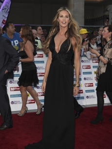Elle MacPherson looks elegant in black arriving at the Pride of Britain Awards at the Grosvenor House Hotel in London on October 3, 2011