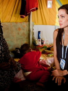 United Nations Goodwill Ambassador Angelina Jolie visits Somali refugees at Shousha Camp, near the Tunis-Libyan border in Ras Djir, Tunisia, on April 5, 2011