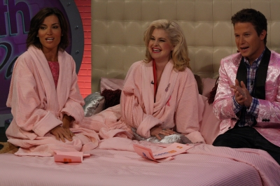 Kit Hoover, Kelly Osbourne and Billy Bush look pretty in pink on the set of Access Hollywood Live on September 30, 2011