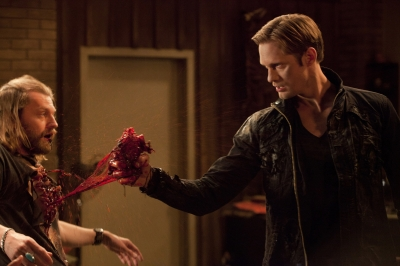 "Eric Northman (Alexander Skarsgard) tears a witch's heart out on ""True Blood,"" Season 4"