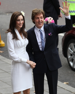 Sir Paul McCartney and Nancy Shevell arrive for their wedding at Marylebone Registry Office in London on October 9, 2011