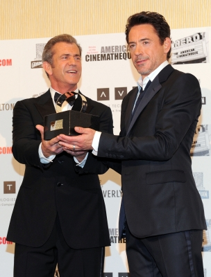 Mel Gibson and honoree Robert Downey Jr. pose together at The 25th American Cinematheque Award Honoring Robert Downey Jr. held at The Beverly Hilton hotel in Beverly Hills, Calif., on October 14, 2011 