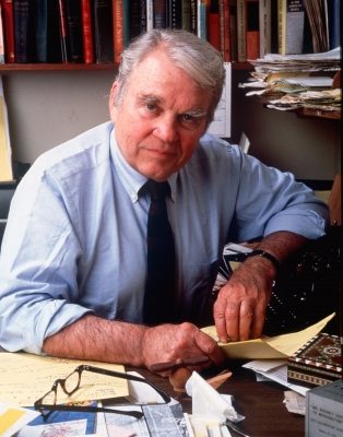 Andy Rooney is seen at his cluttered desk on January 1, 1982