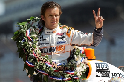 Dan Wheldon, driver of the #98 William Rast-Curb/Big Machine Dallara Honda gestures to photographers during the 95th Indianapolis 500 Mile Race Trophy Presentation at Indianapolis Motor Speedway in Indianapolis on May 30, 2011