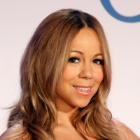 Mariah Carey poses at a press conference to announce that she is the new Jenny Craig Brand Ambassador at Four Seasons Hotel New York on November 9, 2011