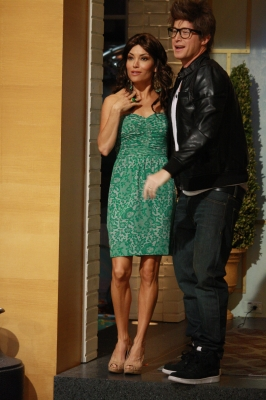 Kit Hoover and Billy Bush show off their Selena Gomez and Justin Bieber costumes on Access Hollywood Live for Halloween 2011