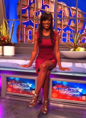 Shaun Robinson posing in a cute red dress with an embellished neckline by Laundry on October 21, 2011