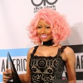 Nicki Minaj, winner of Favorite Rap/Hip-Hop Artist and Favorite Rap/Hip-Hop Album poses in the press room at the 2011 American Music Awards held at Nokia Theatre L.A. LIVE in Los Angeles on November 20, 2011 