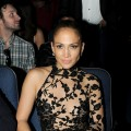 Jennifer Lopez, in lacy couture, watches the 2011 American Music Awards held at Nokia Theatre L.A. LIVE in Los Angeles on November 20, 2011