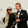Lady Gaga stands with Nigel Lythgoe of Britain, 'American Idol' Executive Producer, after presenting him with The Founders Award at the 39th International Emmy Awards November 21, 2011