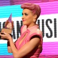 Katy Perry accepts an award onstage during the American Music Award at the Nokia Theatre L.A. LIVE in Los Angeles on November 20, 2011 
