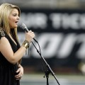 Lauren Alaina performs the National Anthem before the Green Bay Packers take on the Detroit Lions during the Thanksgiving Day game at Ford Field, Detroit, November 24, 2011