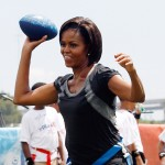 Michelle Obama throws a football at Brock Elementary School in New Orleans, Louisiana, on September 8, 2010