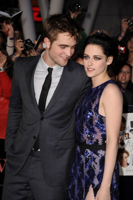 Robert Pattinson looks at his co-star, Kristen Stewart, while at the premiere of 'The Twilight Saga: Breaking Dawn — Part 1' at the Nokia Theatre L.A. Live, Los Angeles, Nov. 14, 2011
