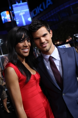 Access' Shaun Robinson poses with Taylor Lautner at the premiere of 'The Twilight Saga: Breaking Dawn — Part 1' at the Nokia Theatre L.A. Live in Los Angeles on November 14, 2011