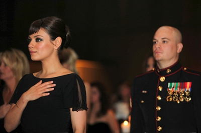 Mila Kunis with Sgt. Scott Moore at the Marine Corps Ball in Greenville, N.C.