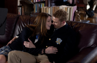 Kellan Lutz steals a quick kiss from Ashley Greene in this scene from 'A Warrior's Heart'