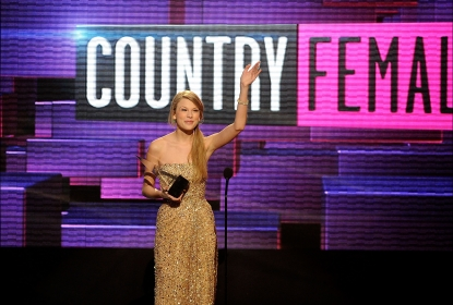 Taylor Swift accepts the award for Favorite Country Female Artist onstage at the 2011 American Music Awards held at Nokia Theatre L.A. LIVE on November 20, 2011