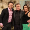 Regis Philbin poses with Billy Bush and Kit Hoover on Access Hollywood Live on November 30, 2011