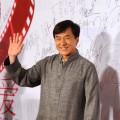 Jackie Chan waves to fans at a TV Channel charity event  in Beijing, China, on December 17, 2011