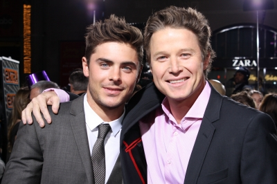 Zac Efron and Billy Bush hug it out on the red carpet at the 'New Year's Eve' premiere in Hollywood on December 5, 2011