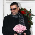 George Michael gives a press conference outside his North London Home in London on December 23, 2011
