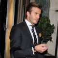 Dapper daddy David Beckham is spotted carrying baby Harper in London on December 31, 2011