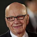Rupert Murdoch poses on the red carpet during the opening ceremony of the Shanghai International Film Festival in Shanghai on June 11, 2011