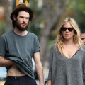 Tom Sturridge and Sienna Miller are seen walking their dog in Notting Hill in London on September 17, 2011