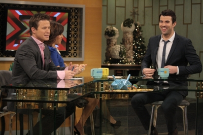 'X Factor' host Steve Jones has a laugh with Billy Bush and Kit Hoover on the set of Access Hollywood Live on December 20, 2011