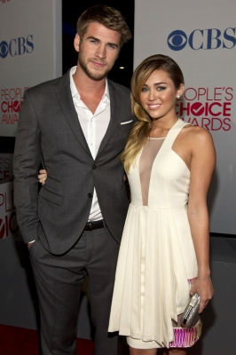 Liam Hemsworth and Actress Miley Cyrus attends People's Choice Awards 2012 at Nokia Theatre LA Live in Los Angeles on January 11, 2012