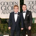 Elton John and David Furnish arrive at the 69th Annual Golden Globe Awards held at the Beverly Hilton Hotel in Beverly Hills, Calif. on January 15, 2012