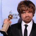 The winner for Best Performance by an Actor in a Supporting Role in a Series, Mini-Series or Motion Picture Made for Television Peter Dinklage poses with the trophy at the 69th annual Golden Globe Awards at the Beverly Hilton Hotel in Beverly Hills, January 15, 2012