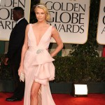 Charlize Theron poses at the 2012 Golden Globe Awards